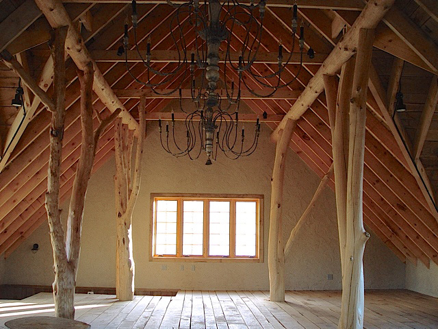 Rustic private artist studio - semi-raw alder tree supports, exposed wood trusses.