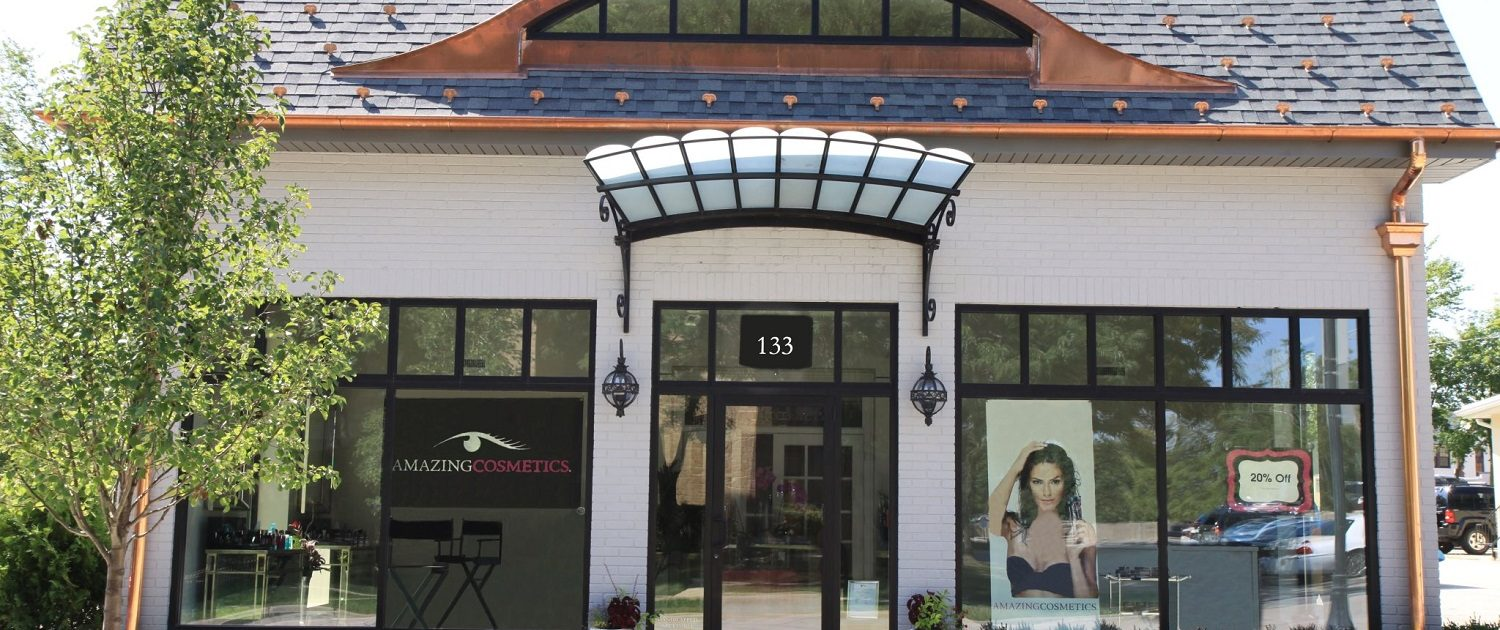 Exterior view of AmazingCosmetics, design features include eyebrow window and glass canopy to match the glamorous image of the brand.