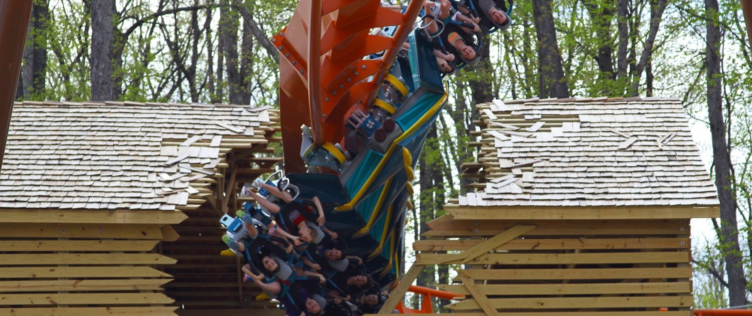 This image show the near-miss fly-thru element when the coaster track breaks through a barn.