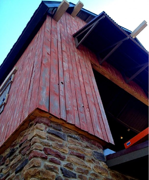 This image is a close up of the materials used to build the launch station, including stonework and hand-weathered barn wood.