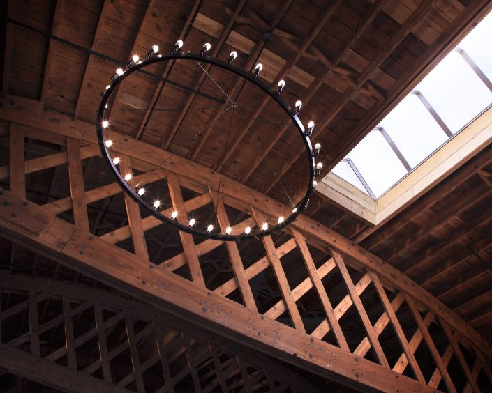 Mickey Finn's building interior features a soaring barrel vault ceiling and massive bowstring trusses that have been sandblasted and restored.
