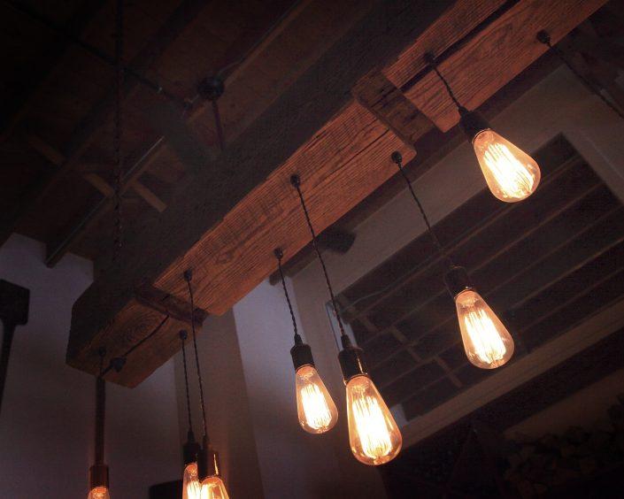 Pizzeria DeVille custom made rustic light fixture.