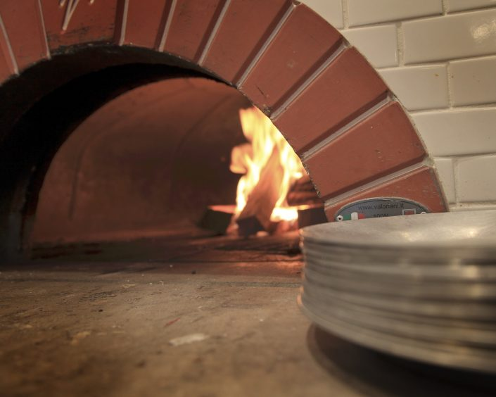Pizzeria DeVille wood buring pizza oven.