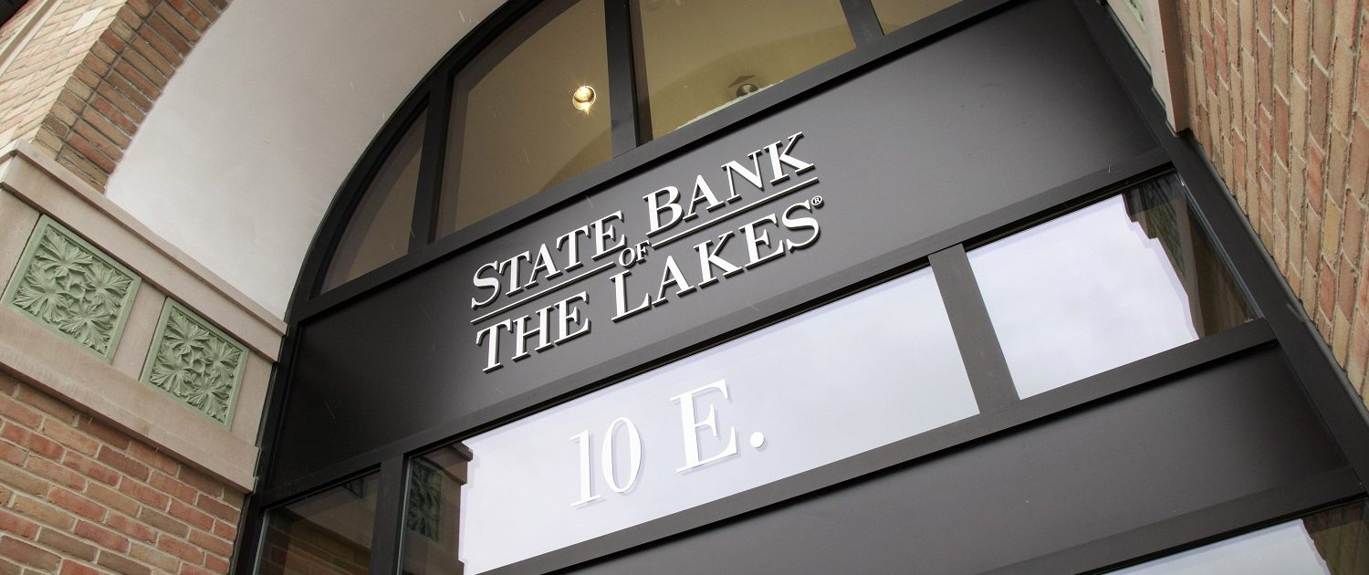 Two-story entrance of State Bank of The Lakes in Round Lake, IL.