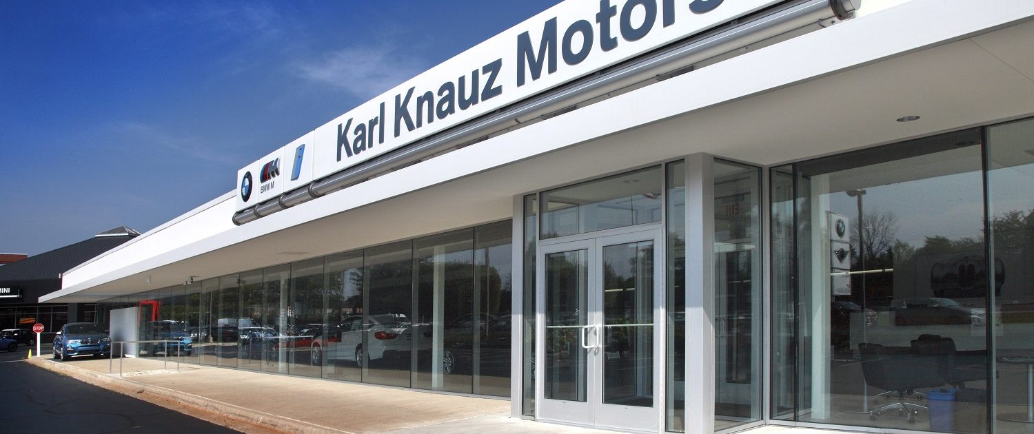 The dominant use of the brand color white reinforces the sophistication of the BMW brand on Knauz Motors new modern exterior facade.