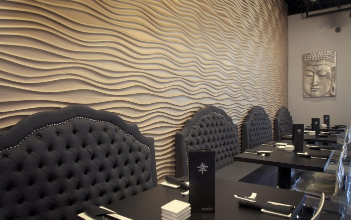 Shakou St. Charles plaster-skinned wave wall design element in the first floor dining room.