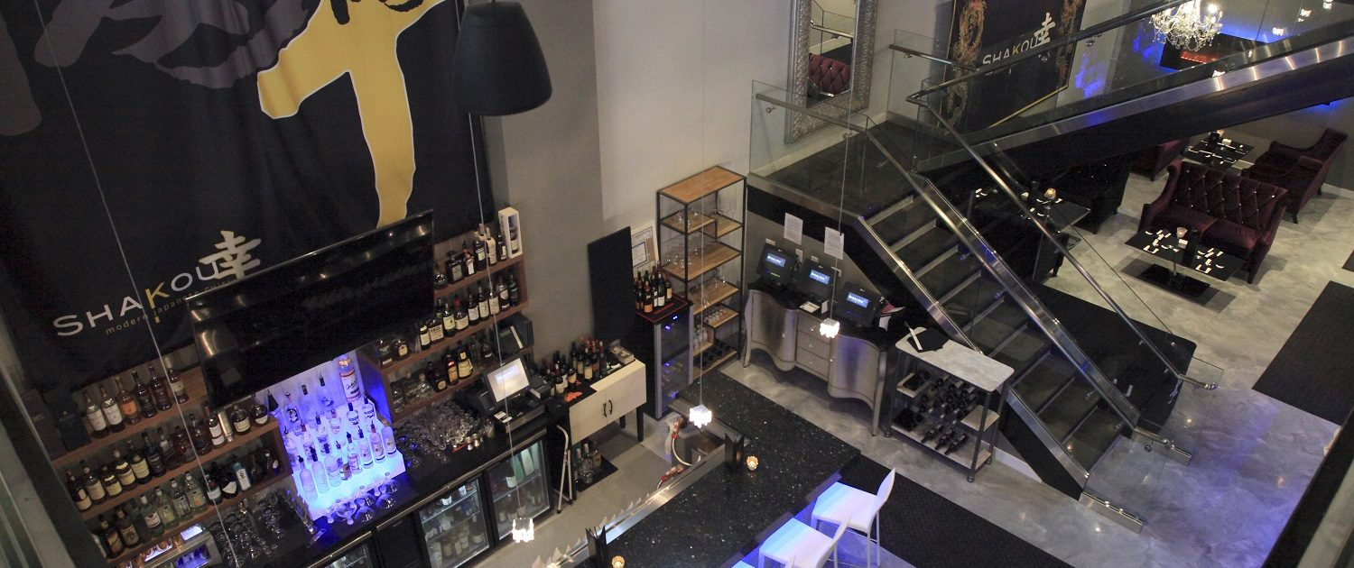 The image is of Shakou St. Charles location from the upper level looking down on the open and spacious bar area..
