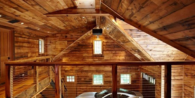 This image shows a dream garage built with hard wood interior and mezzanine.