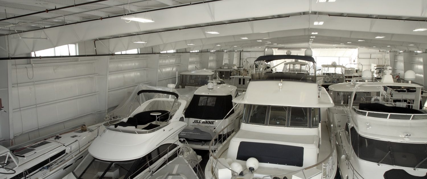 Larsen Marine - Boat Warehouse, interior view filled with boats.