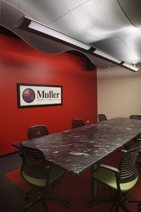 Muller Trading Company conference room. Wave wall design element made of aluminum.