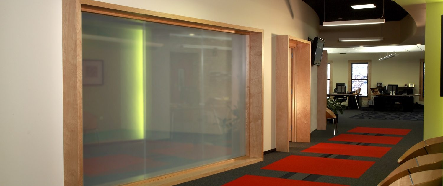 The glass walled conference room can become completely private with a flick of the switch through the use of electric privacy glass.