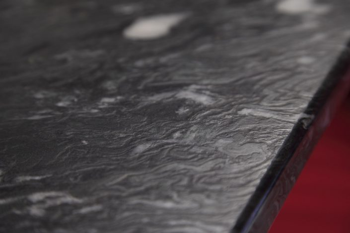 Muller Trading Company conference room table made out of black marble.