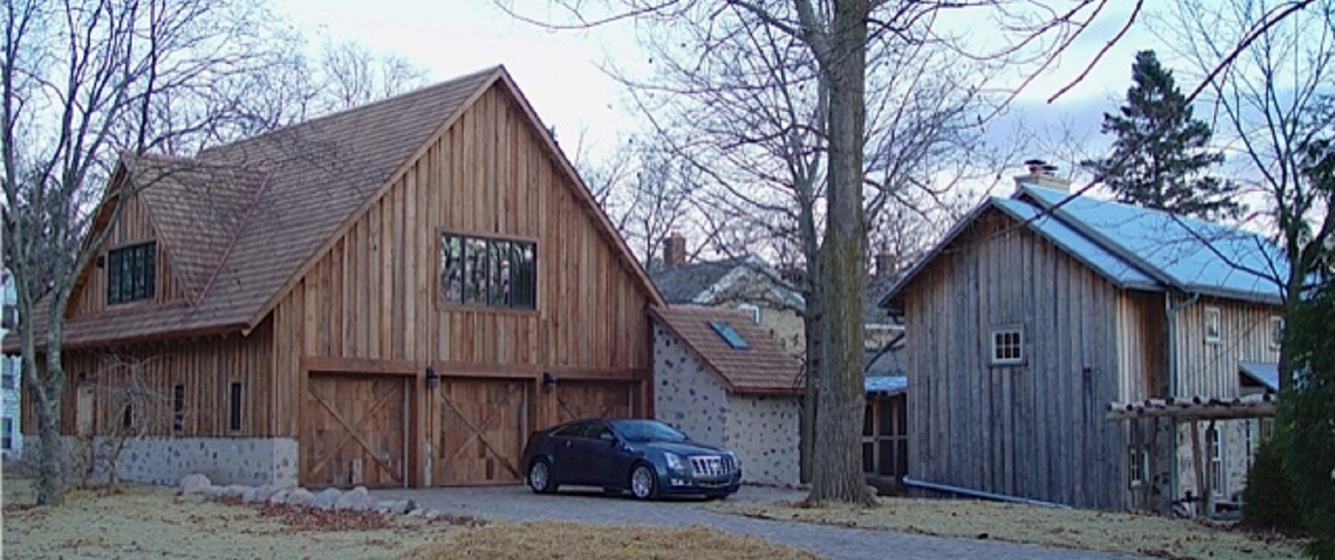 Private Artist Studio - exterior walls are sided with walnut shingles and the windows are energy-efficient Marvin casements. Walnut shingles cover the white oak roof structure and genuine granite cobbles pave the driveway and garage floor.